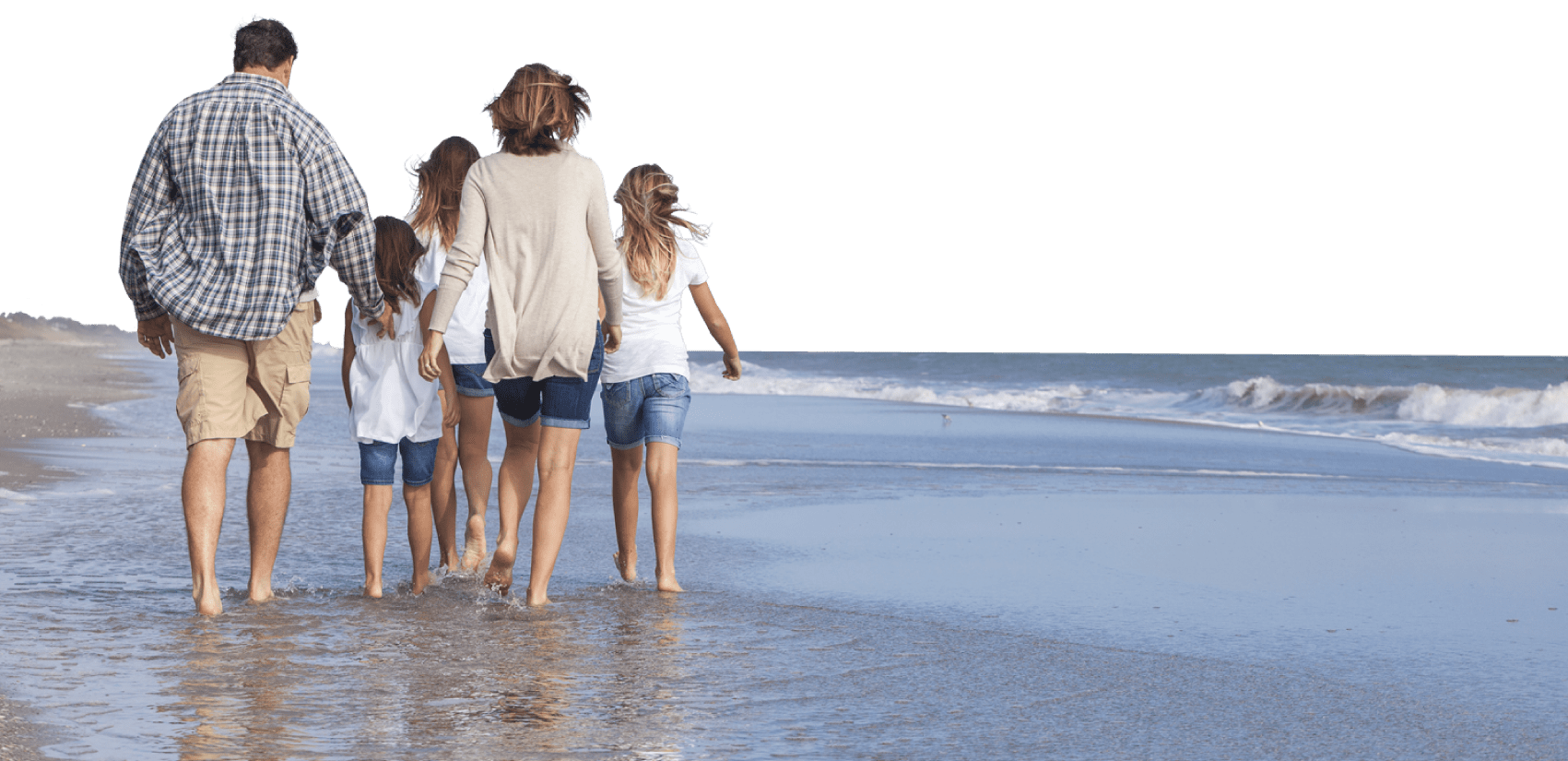 full width image of family walking on the beach