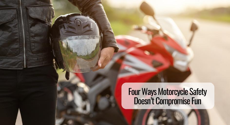 image of motorcycle rider holding helmet